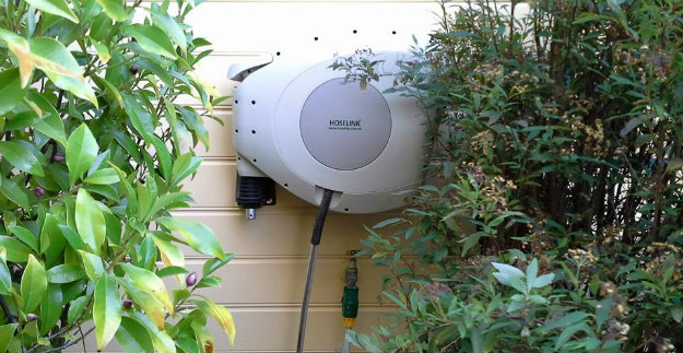 Hoselink Retractable Reel hanging on a clad wall