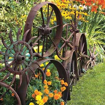 A fence made up of old metal wheels