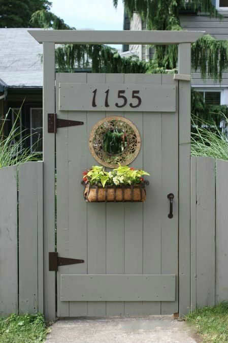 Simple grey gate with flower basket