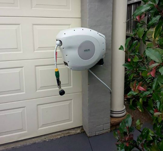 Hoselink Retractable Reel Mounted to the front of the house