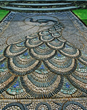 A path made of tiny stones dipicting a peacock