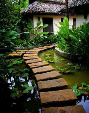 Slabs make a floating stepping stone path over pond