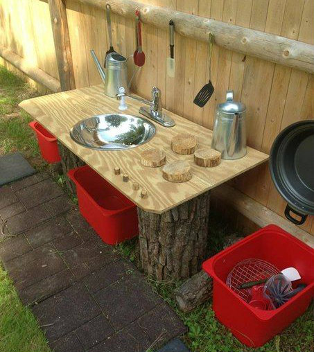 Basic Mud Kitchen made from tree stumps