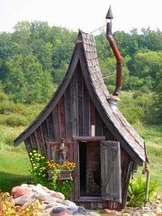 shed with tall pointy roof like a fairy tale house