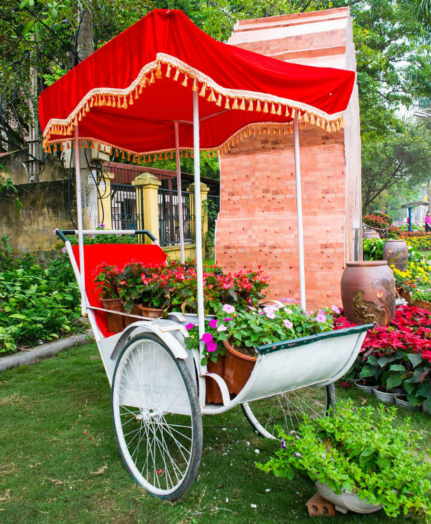 Unusual Garden Ornaments - cart with flower pots and a bright red cover
