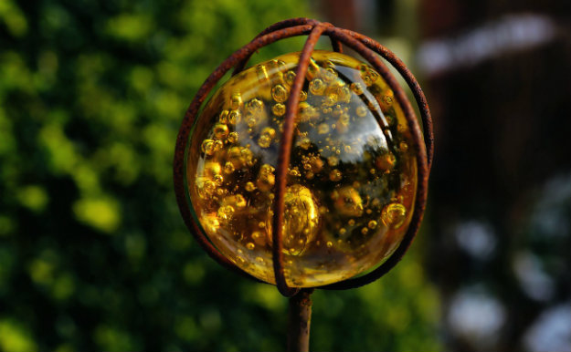 Unusual Garden Ornament - amber orb on a spike