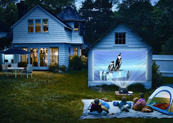Set up a projector in the garden for a backyard cinema