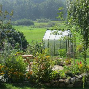 Green house at the bottom of a garden