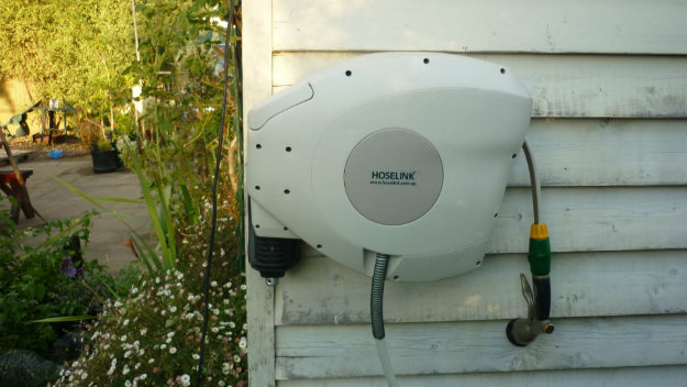 Hoselink Retractable Reel mounted onto a wooden building