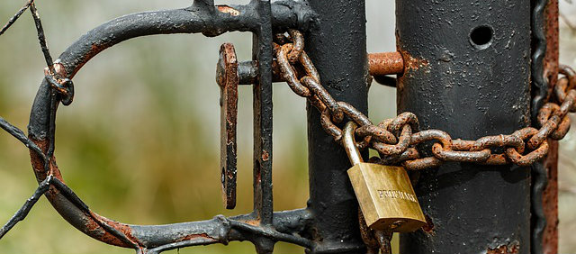 DIY Home Security Tips - padlock and chain locked gate