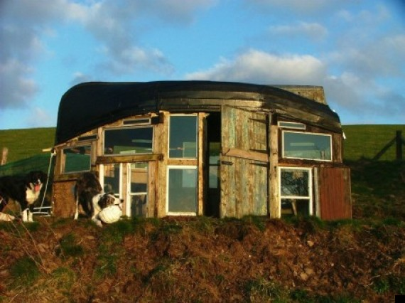 upside down boat and old window panes make this shed